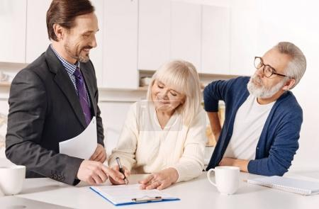 agent working with elderly couple of customers