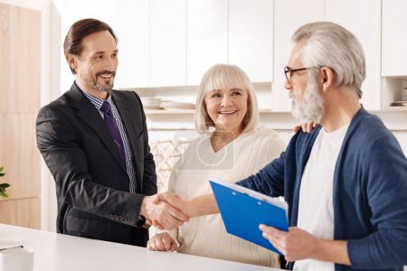 Cheerful real estate agent presenting contract