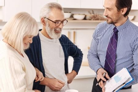 Friendly realtor presenting the contract for apartment