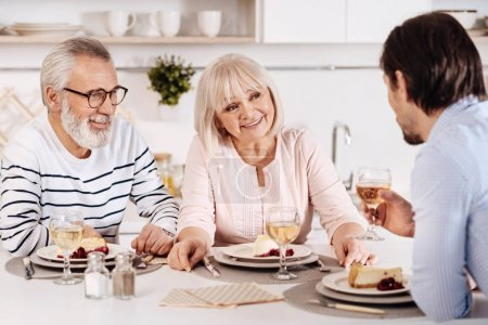 Cheerful family sitting at the dinner table