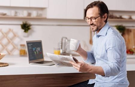 Optimistic businessman enjoying freelance work