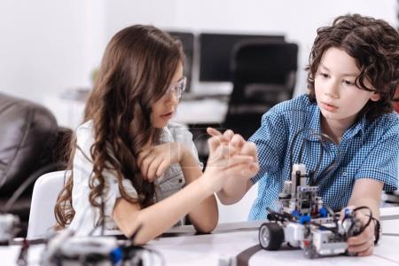Friendly pupils testing modern technologies