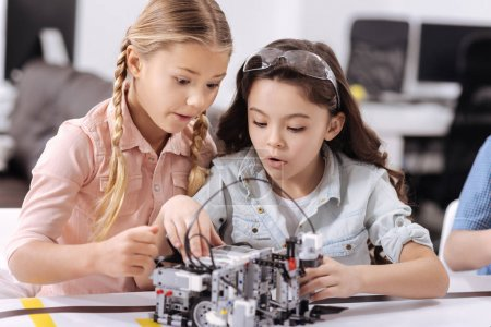Surprised young scientists having tech class