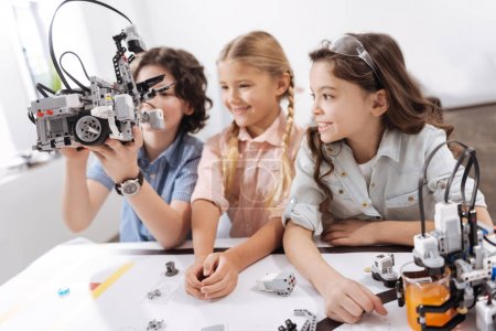 Amused kids exploring modern technologies
