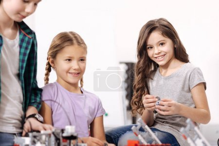 Charming kids enjoying science experiment at school
