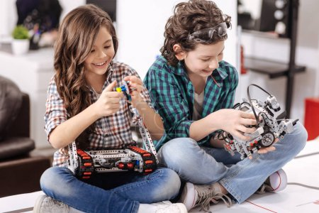 children playing with gadgets and devices
