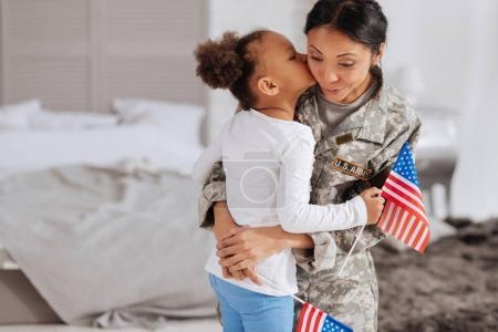 girl kissing her beloved mother