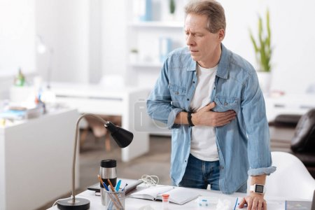 Anxious man having heart attack