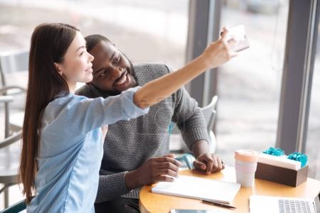 International couple doing selfie
