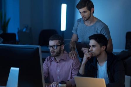 Intelligent handsome programmer working on the computer