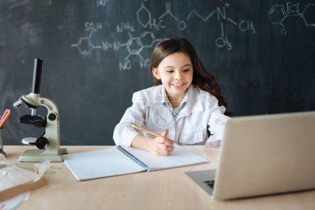 Multitasking girl doing homework