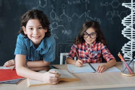 Optimistic pupils studying foreign languages
