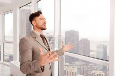 Successful businessman enjoying the view from his office