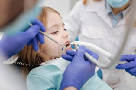 Little ginger girl having her teeth treated