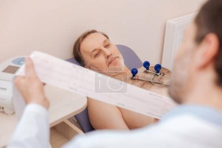 Optimistic elderly patient hoping for positive results