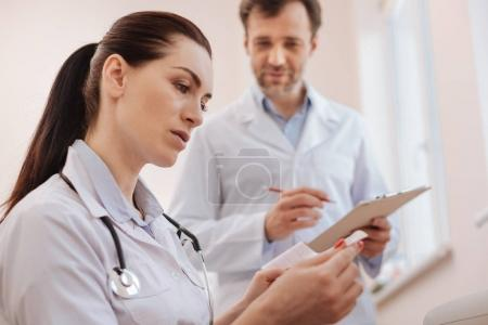 Competent capable cardiologist looking focused