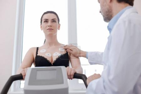 Young gorgeous lady having her cardiovascular system checked