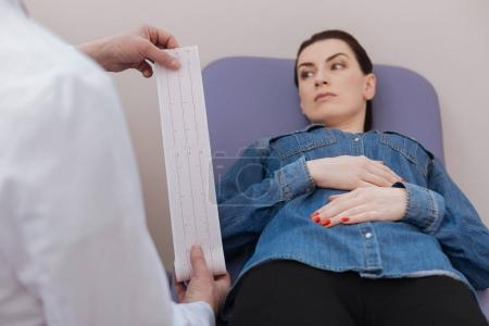 Troubled thoughtful woman waiting for doctors decision