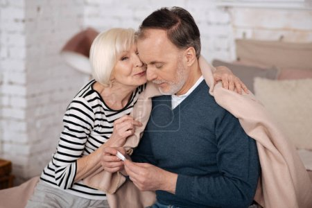 Old lady giving solace to her sick husband