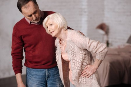Elderly lady with pain near her husband.