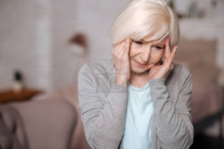Close up of aged lady with headache