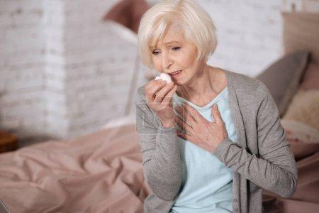 Elderly lady sick woman feeling bad