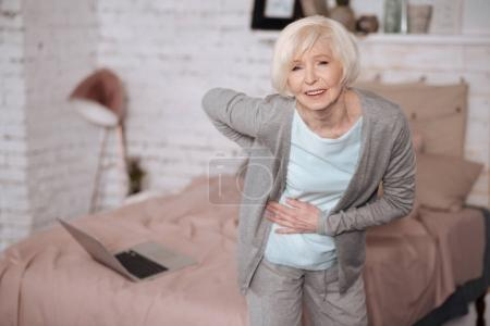 Aged woman with bad backache