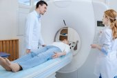Positive experienced doctor doing brain tomography