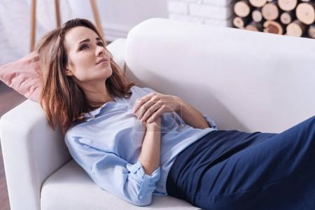 Attractive thoughtful woman dreaming about something