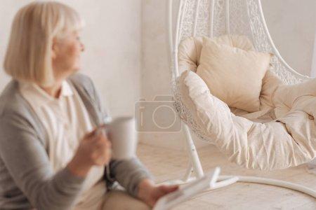 Selective focus of an empty armchair