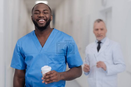 Delightful African American intern enjoying working hours in the hospital