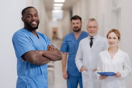 Cheerful African American intern expressing happiness in the hospital