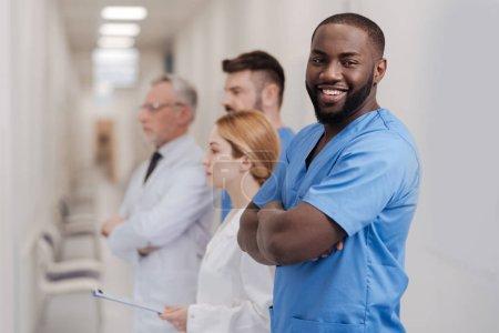 Nice African American intern enjoying working in the clinic
