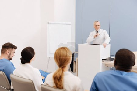 Experienced professor giving a lecture in the medical university
