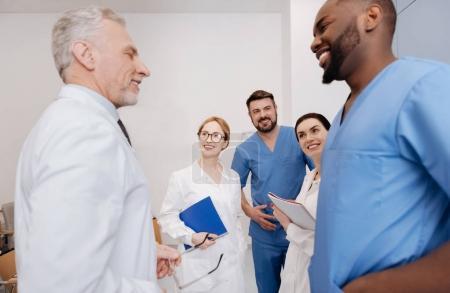 Joyful young interns graduating from the medical university