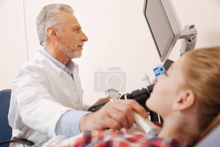 Aging physician making ultrasound monitoring