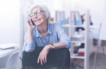 Relaxed mature woman having telephone call