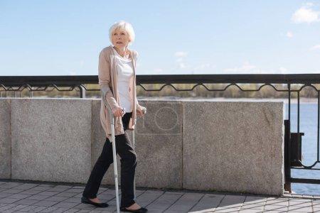 Senior lady looking around on the street