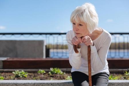 Sad woman watching at birds outdoors