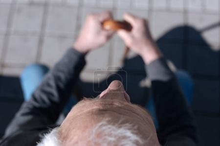 Wrinkly pensioner peering in the open air