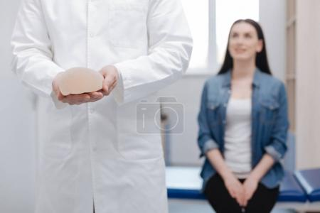 doctor receiving a visit from young lady