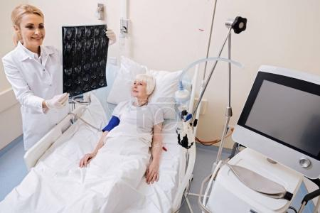 Trained capable doctor looking at the set of scans
