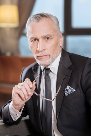Appealing senior man worrying about business
