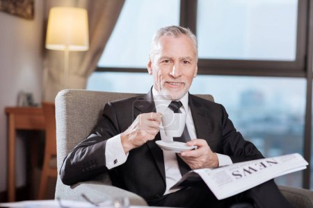Senior happy man drinking coffee