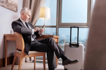 Senior glad businessman  ready to leave