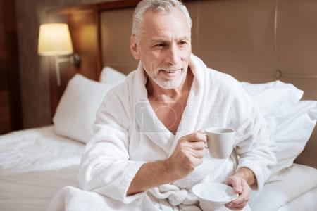 Glad senior man starting new morning