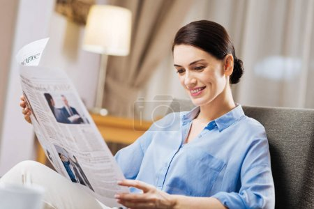 Joyful merry woman emerged into reading