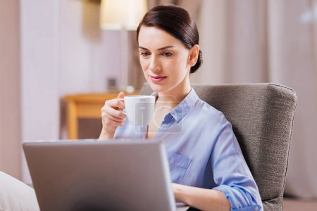 Budding attractive woman working with cup of tea