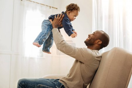 Loving father playing with his son