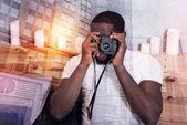 Nice handsome man holding a camera